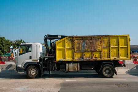side view of dump truck vehicle, dirty - 写真素材