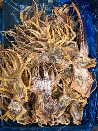 dried squid on food market in China, Dry seafood - Stock Photo