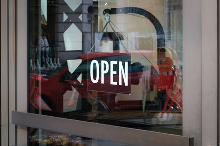 we are open sign on shop door - store window with open sign -