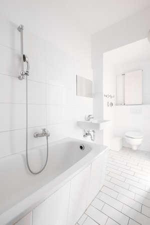 tiled, white bathroom, modern bath with bathtub -
