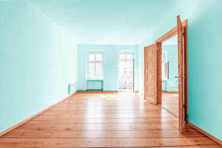 Painted room in renovated flat with wooden floor