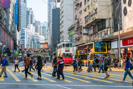 HongKong, November, 2019: People on crowded street in shopping district (Causeway Bay) in Hong Kong city Éditoriale