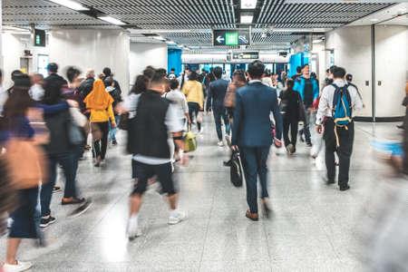 HongKong, China - November, 2019: People walking inside MTR station / underground subway train station in HongKong Editorial