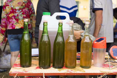 Bottles of bees honey displayed for selling in mountainous road of Vietnam