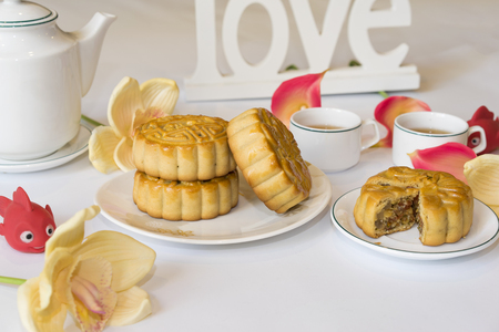 Moon cake, food for Vietnamese mid autumn festival. Focus on moon cake and others are blurred Stock Photo