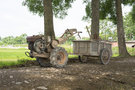 transforms: Plough tractor transforms to small wagon for carrying agriculture products.