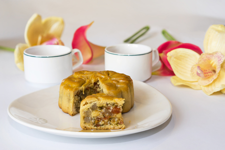 vietnamese ethnicity: Moon cake, food for Vietnamese mid autumn festival. Focus on moon cake and others are blurred Stock Photo