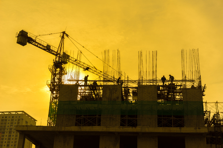 Silhouette of under construction building at twilight Stock Photo