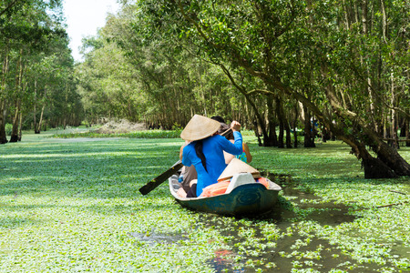 conical hat: Tourism rowing boat in Mekong delta, Vietnam