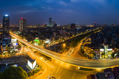 Aerial view of Hanoi skyline cityscape at sunset time at intersection Nguyen Chi Thanh - Lang - Tran Duy Hung street Stock Photo