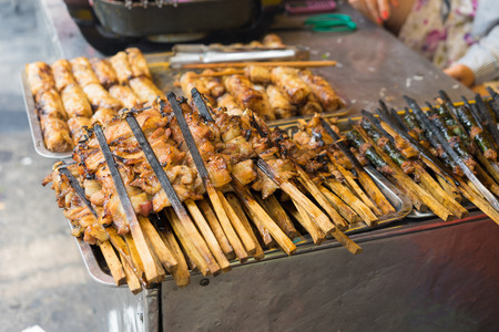Barbecue meat - the ingredient of bun cha is the famous Vietnamese noodle soup with bbq meat, spring roll, vermicelli and fresh vegetable served on bamboo flat basket