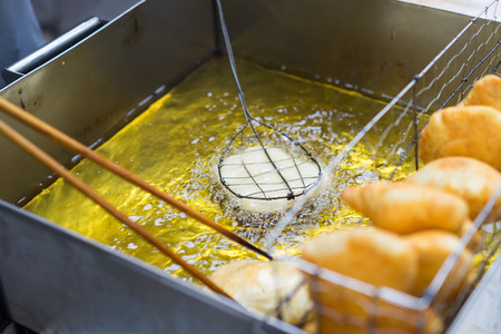 Goi cake is frying on home-made square pan on Hanoi street
