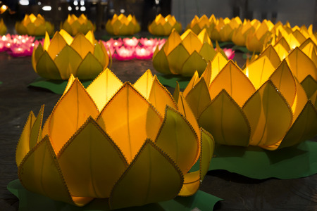 Flower garlands and colored lanterns for celebrating Buddhas birthday in Eastern culture. They are made from cut paper and candle