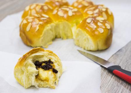Homemade sweet bun with almond and dried grape Stock Photo