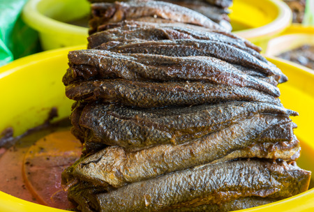 Dried fish with salt and spice added, the popular food for rural people in Mekong delta, south of Vietnam Stock Photo
