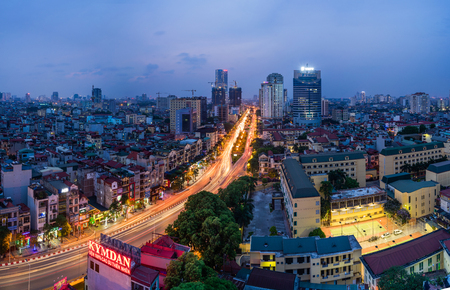 overbridge: Aerial view of Hanoi skyline cityscape at sunset time at intersection Nguyen Chi Thanh - Lang - Tran Duy Hung street Stock Photo
