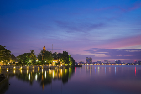 Tran Quoc pagoda in the afternoon in Hanoi, Vietnam. This pagoda locates on a small island near the southeastern shore of West Lake. This is the oldest Buddhist temple and tourist destination in Hanoi Stock Photo