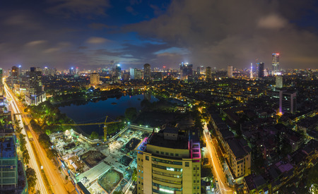 Aerial view of urban skyline at twilight. Hanoi cityscape. Thanh Cong lake and Lang Ha street