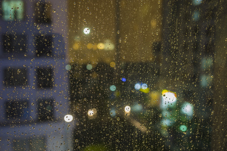 shallow dof: Shallow DOF of water drops on glass with bokeh and apartment building on background