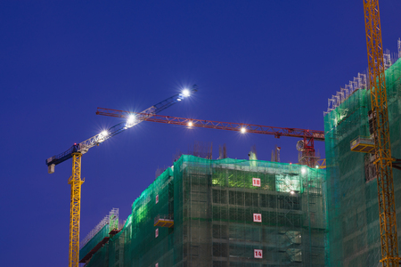 Apartment building construction site at night