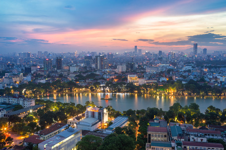 Aerial skyline view of Hoan Kiem lake (Ho Guom, Sword lake) area at twilight. Hoan Kiem is center of Hanoi city. Hanoi cityscape. Imagens