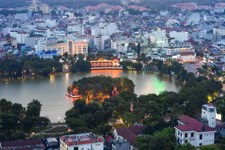 Aerial skyline view of Hoan Kiem lake (Ho Guom, Sword lake) area at twilight. Hoan Kiem is center of Hanoi city. Hanoi cityscape. Reklamní fotografie