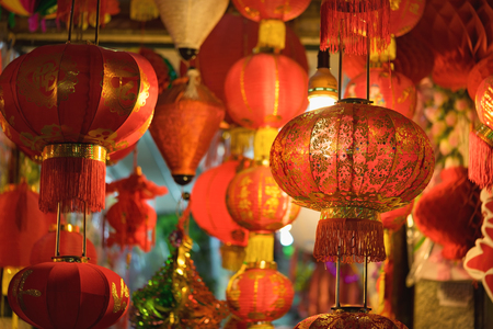 vietnamese ethnicity: Asian red lantern. The printed word on lantern means happy and prosperous Stock Photo