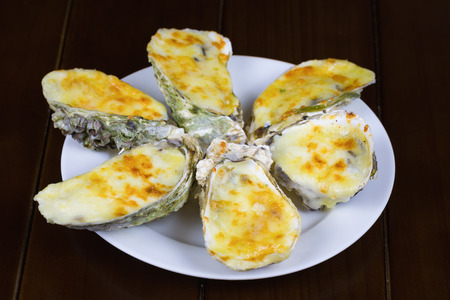 Cheese grilled oyster on dish