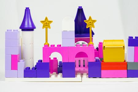 Colourful plastic toy building blocks Stock Photo