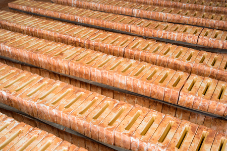 Molds for producing Asian ceramic roof tiles in production workshop Stock Photo