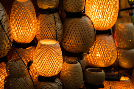 Decorative lanterns made of handicraft bamboo braid basket in Hoi An ancient town, Vietnam