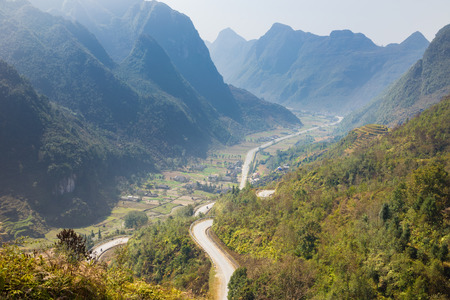 ha giang: Country view with curve road, yellow tree and mountain in Ha Giang province, Vietnam