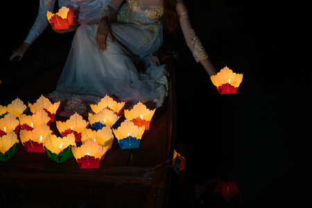 Paper lantern in Vietnamese woman hand in Hoi An ancient town, Vietnam.  The lanterns are set into the river as an offering and to worship their ancestors as well as the God of the land Reklamní fotografie