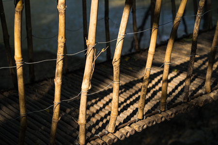 suspenso: Dried bamboo of walking suspense bridge, shined by afternoon yellow sunlightbridge