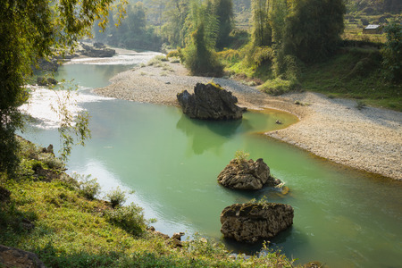 View of calm river under morning sunlight