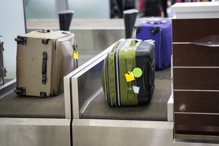 Luggage on weight at check-in counter at airport