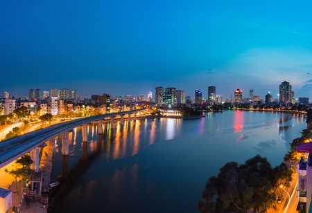 Aerial view of Hanoi cityscape by twilight period, with Dong Da lake and under construction Cat Linh - Ha Dong elevated railway