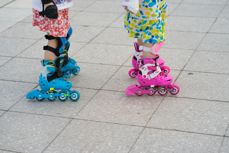 roller blade: Closeup children roller skating