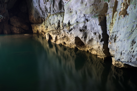 River and rock cliff inside of Phong Nha Cave in Phong Nha-Ke Bang National Park, a UNESCO World Heritage Site in Quang Binh Province, Vietnam