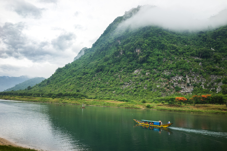 Landscape in Phong Nha-Ke Bang National Park, the river is entrance to famous tourist destination Phong Nha cave, a UNESCO World Heritage Site in Quang Binh Province, Vietnam Stock Photo