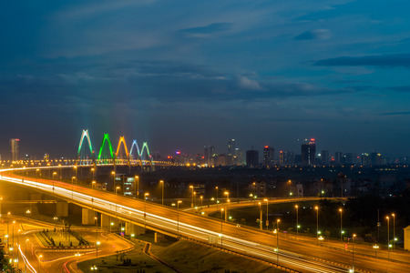 Hanoi skyline at twilight at Vo Chi Cong street, leading to Nhat Tan cable-stayed bridge, Dong Anh district Stock Photo