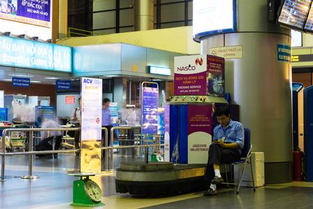 personel: Hanoi, Vietnam - Nov 27, 2014: Luggage packing area in Noi Bai international airport