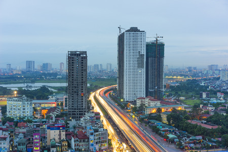 Capital Hanoi cityscape at twilight. Hanoi is on the way to modern city as a lot of high building risen nowadays Editorial