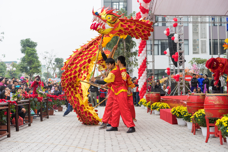 ancient lion: Hanoi, Vietnam - Feb 7, 2015: A show of lion and dragon dance at Vietnamese lunar new year festival organized at Vinschool, Vinhomes Times City, Minh Khai street