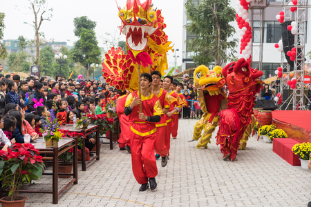 Hanoi, Vietnam - Feb 7, 2015: A show of lion and dragon dance at Vietnamese lunar new year festival organized at Vinschool, Vinhomes Times City, Minh Khai street