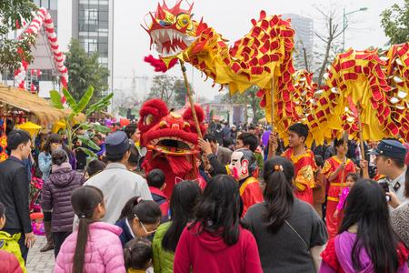 Hanoi, Vietnam - Feb 7, 2015: A show of lion and dragon dance at Vietnamese lunar new year festival organized at Vinschool, Vinhomes Times City, Minh Khai street
