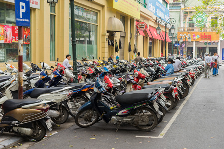 lacks: Hanoi, Vietnam - Mar 15, 2015: The parking of motorbikes on street in Trang Tien street. Hanoi lacks of parking area for motorbike and car