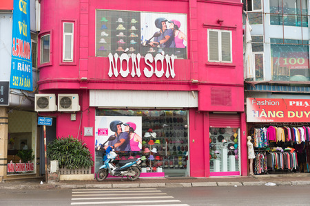 Hanoi, Vietnam - Mar 15, 2015: Exterior facade view of Non Son shop. Non Son is famous brand name of high quality motorcycle helmet, male and female fashion hat in Vietnam