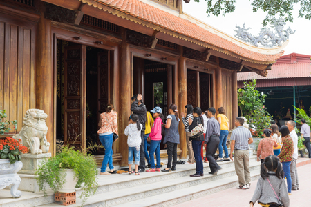 Quang Ninh, Vietnam - Mar 22, 2015: People make ceremonial offerings at Cai Bau pagoda. Giac Tam Meditation Monastery, also known as Cai Bau Pagoda, nestles on a 20-hectare plot in Van Don District Editorial