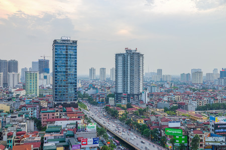 overbridge: Hanoi, Vietnam - May 14, 2015: Aerial view of Hanoi skyline cityscape at Nguyen Chi Thanh street at sunset time Editorial